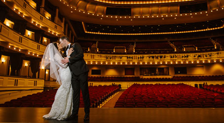 Bride and groom on the stage of Mahaffey Theare